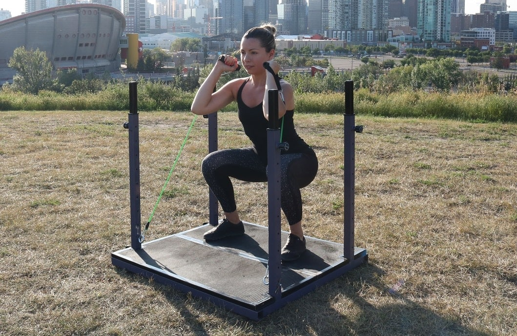 How to Do Squats With Resistance Bands (Outdoors)